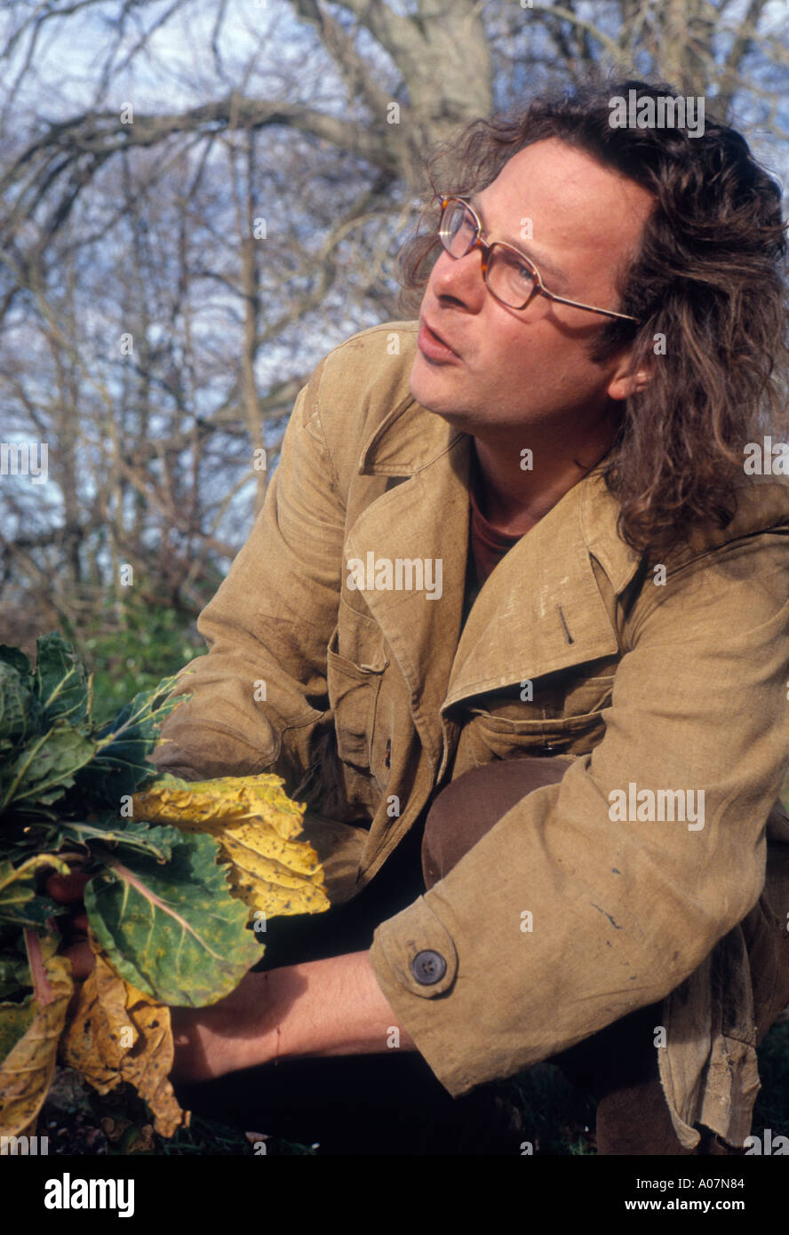 TV food Chef Hugh Fearnley Whittingstall collects cabbages at the River Cottage in Dorset - Stock Image