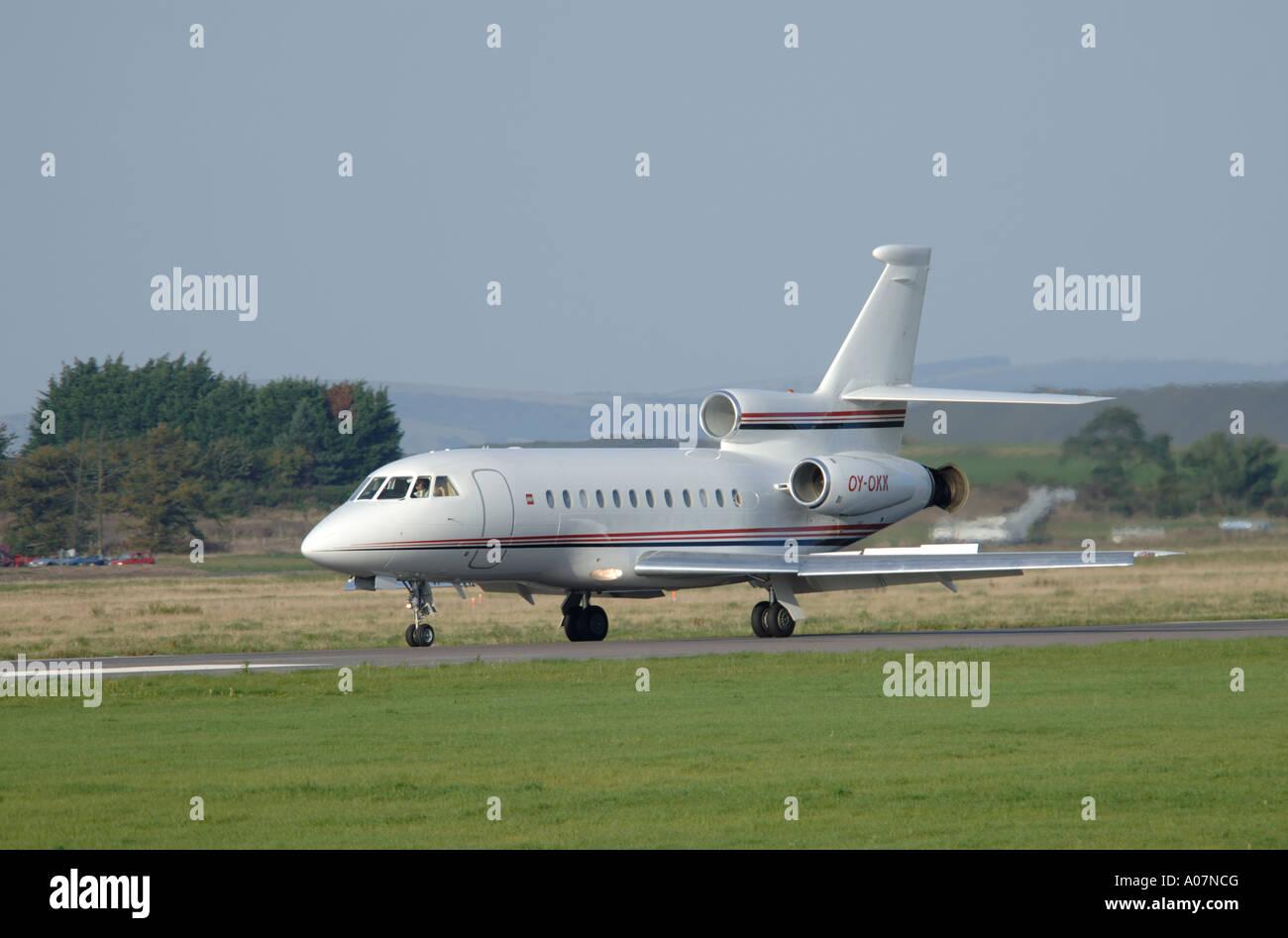 Dassault Falcon 900 super large Tri Jet departing Inverness Dalcross Airport.  XAV 3994-380 - Stock Image