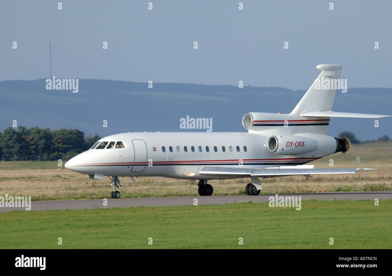 Dassault Falcon 900 super large Tri Jet departing Inverness Dalcross Airport.  XAV 3995-380 - Stock Image