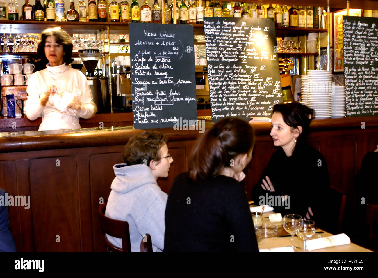 PARIS France People Family Sharing Meals Eating In French Bistro Restaurant Camille Blackboard Menus On Display Marais