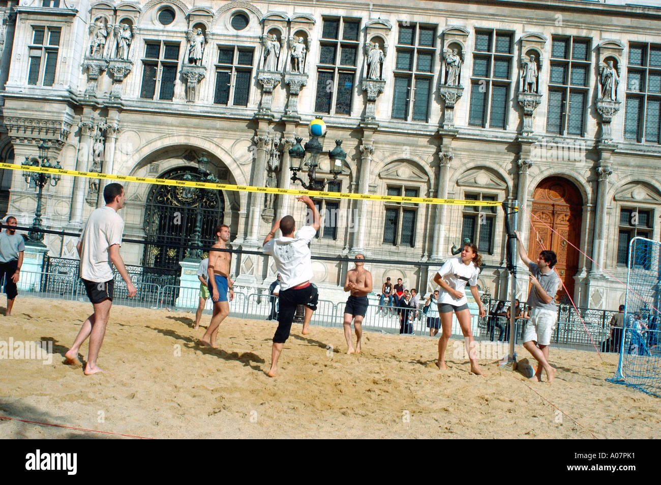Paris France, Mixed Group French Teens On 'Paris Plages' Event, Playing Beach Volleyball on Street River Seine plage - Stock Image