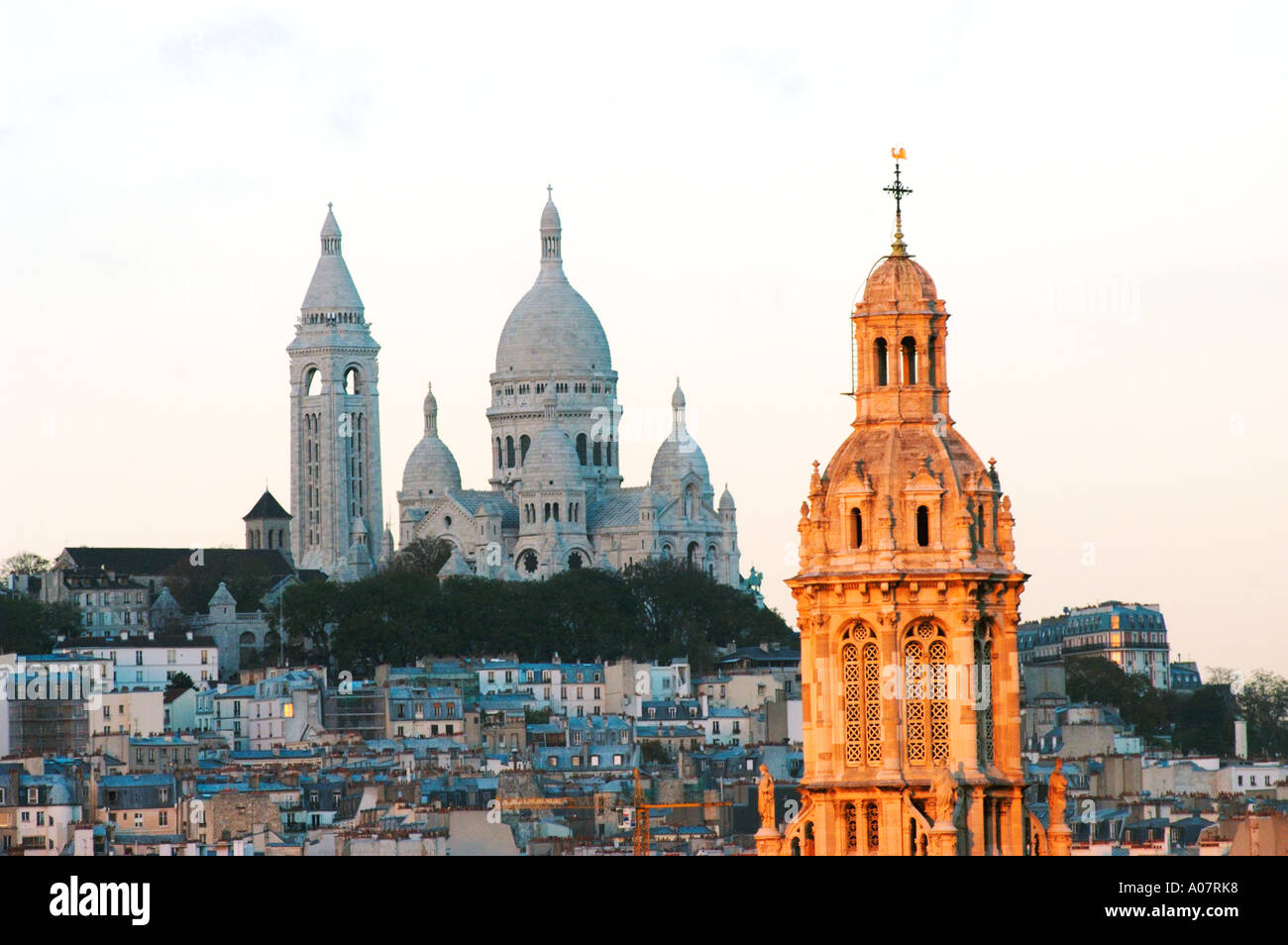 Paris France, Overview 'Sacre Coeur' Basilica on Montmartre Hill with 'Holy Trinity Church' Cityscape, urban landscapes, Scenic - Stock Image