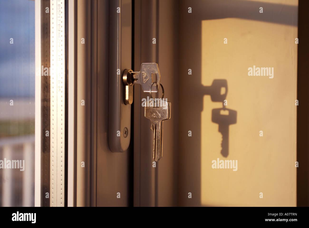 Keyes In Door Lock - Stock Image