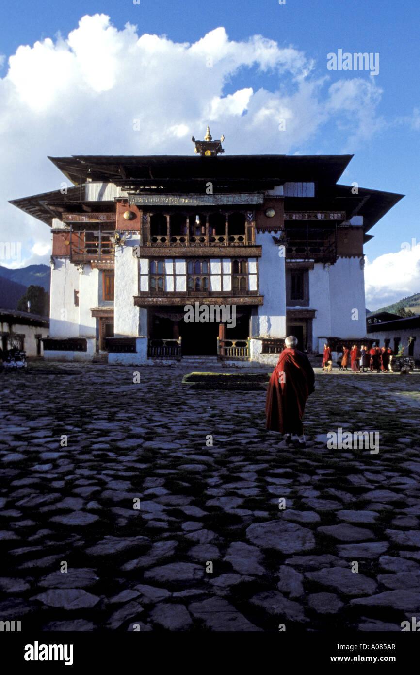 Monk in Cobble Stone Courtyard of Gangtey Gompa, Phobjika Valley, Bhutan - Stock Image