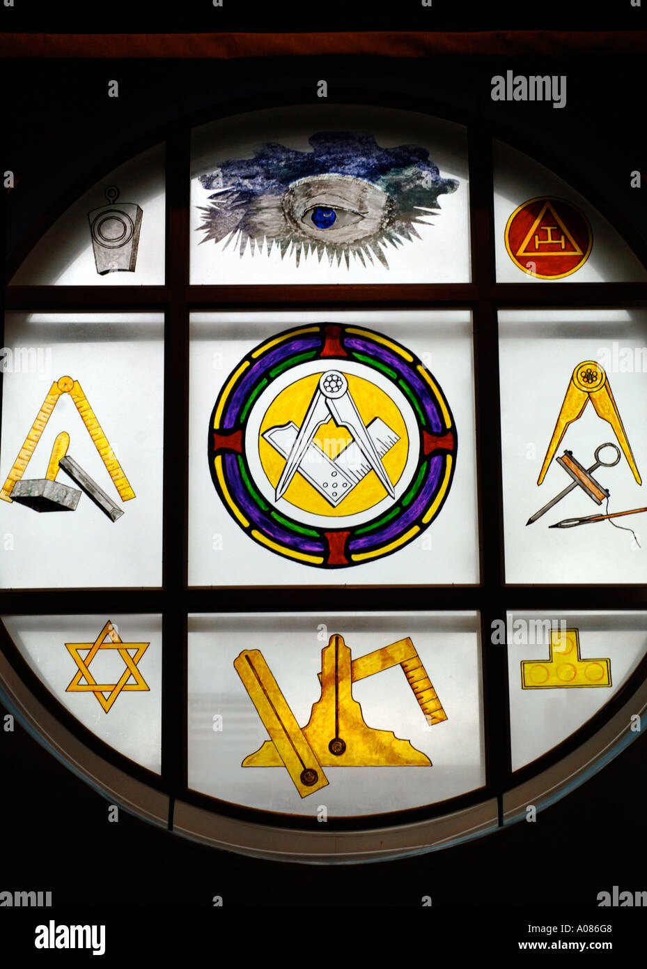 Close up of a plate glass window showing masonic symbols in a Freemasons Lodge - Stock Image