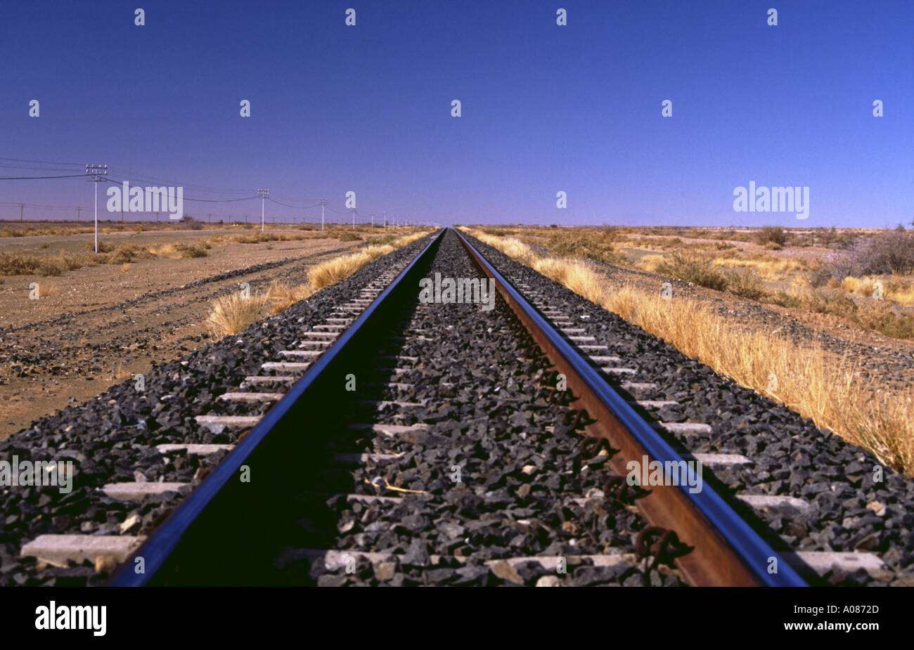 Railway line endless straight desert lonely South Africa train line tracks railroad - Stock Image