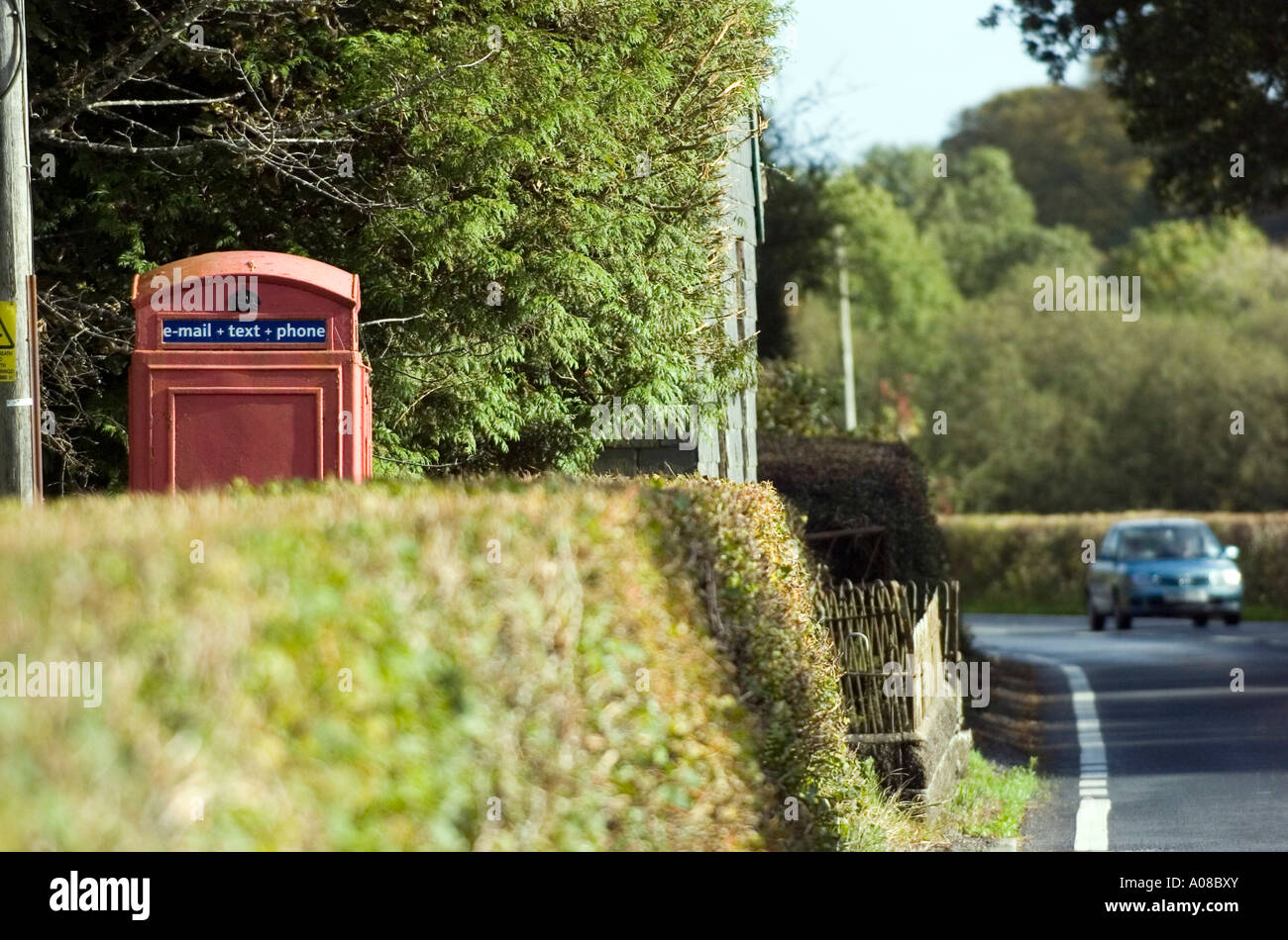 Old style BT phonebox with email and text facilities on the side of the road in the remote countryside near Dolgellau, UK. - Stock Image