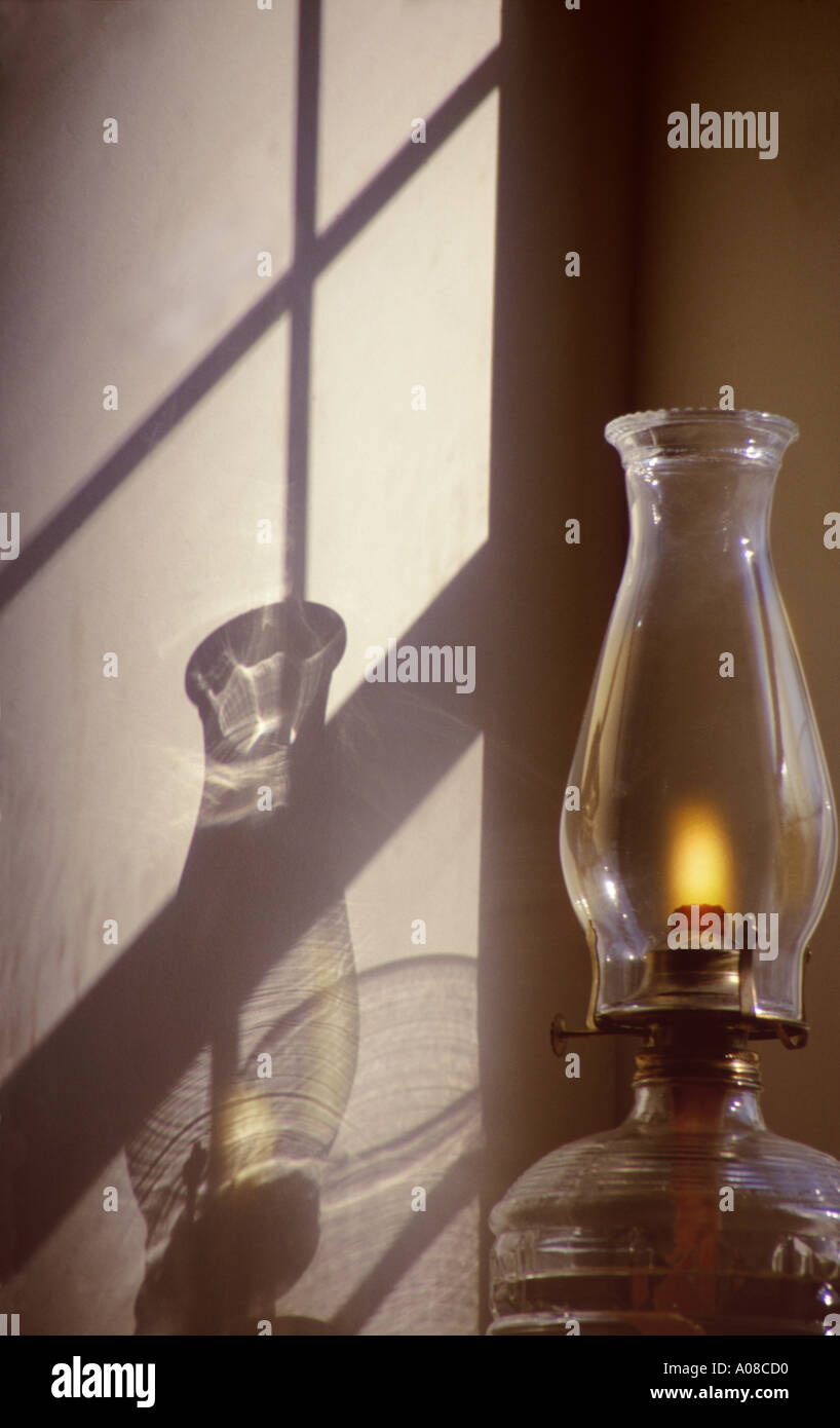 Oil lamp and shadow in window - Stock Image
