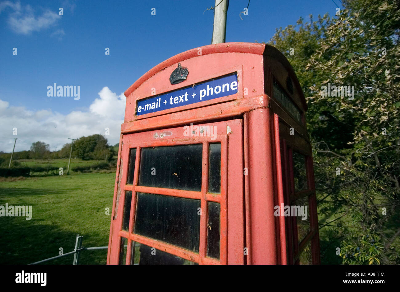 Old style BT phonebox with email and text facilities. - Stock Image