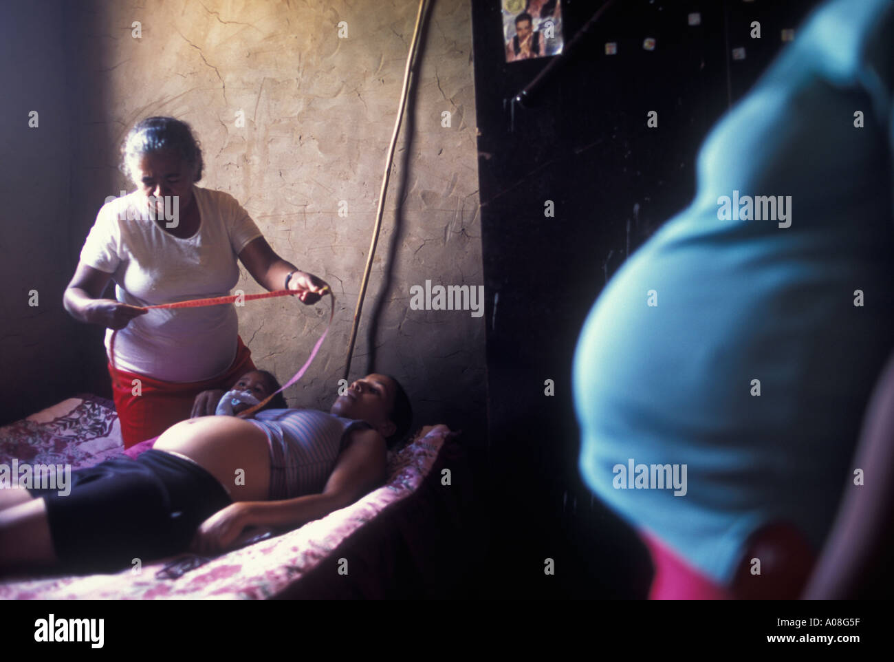 Midwife Edite Maria da Silva take care of one of the pregnant women who lives in her community Previous to birth exams held at - Stock Image