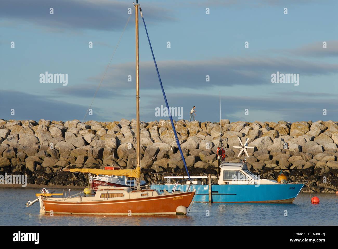 Moored Boats Breakwater Rhos on Sea North East Wales - Stock Image