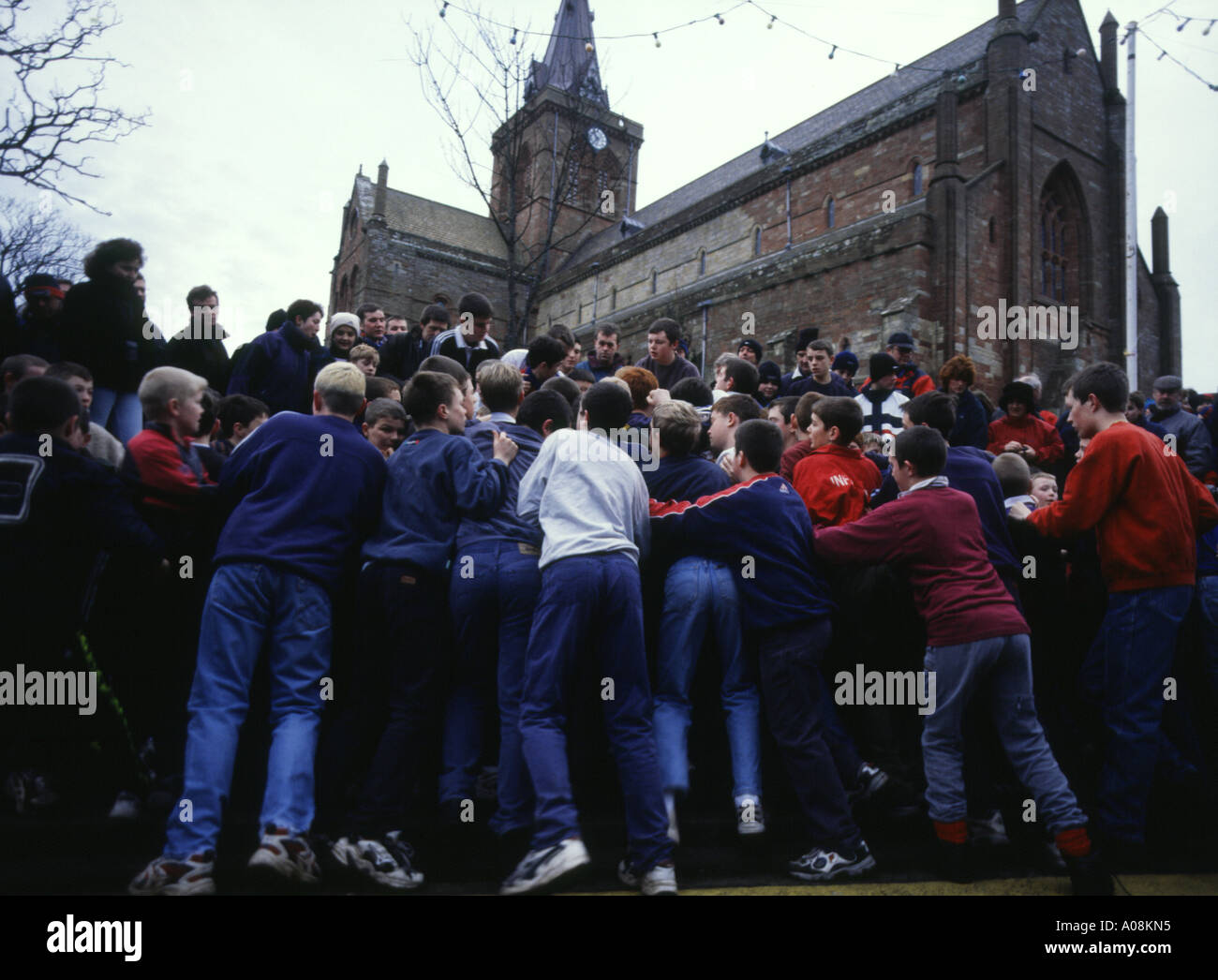 dh The Ba KIRKWALL ORKNEY Boys New Year Ba in Broad Street St Magnus cathedral youngsters kids Stock Photo