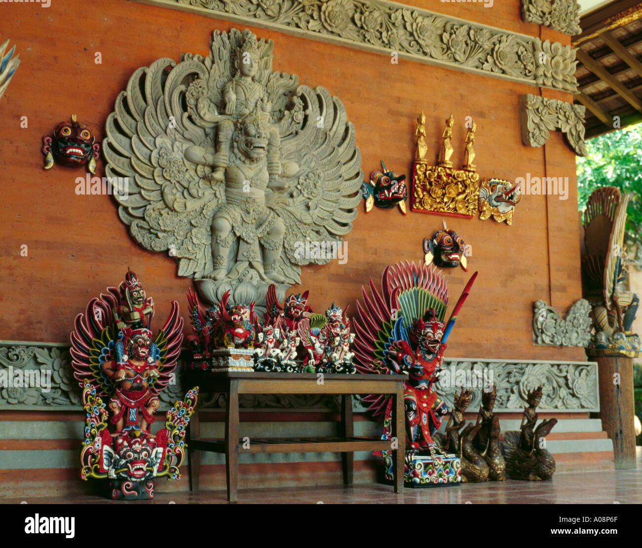 Display of local handicrafts and ornate wall decoration on a house, Bali, Indonesia, Asia. - Stock Image