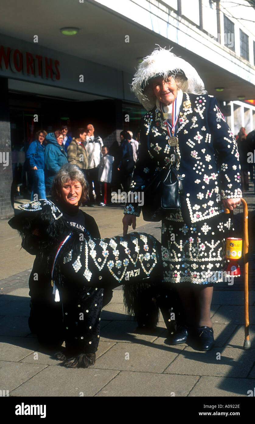Pearly queen and dog in Burnley Lancashire - Stock Image