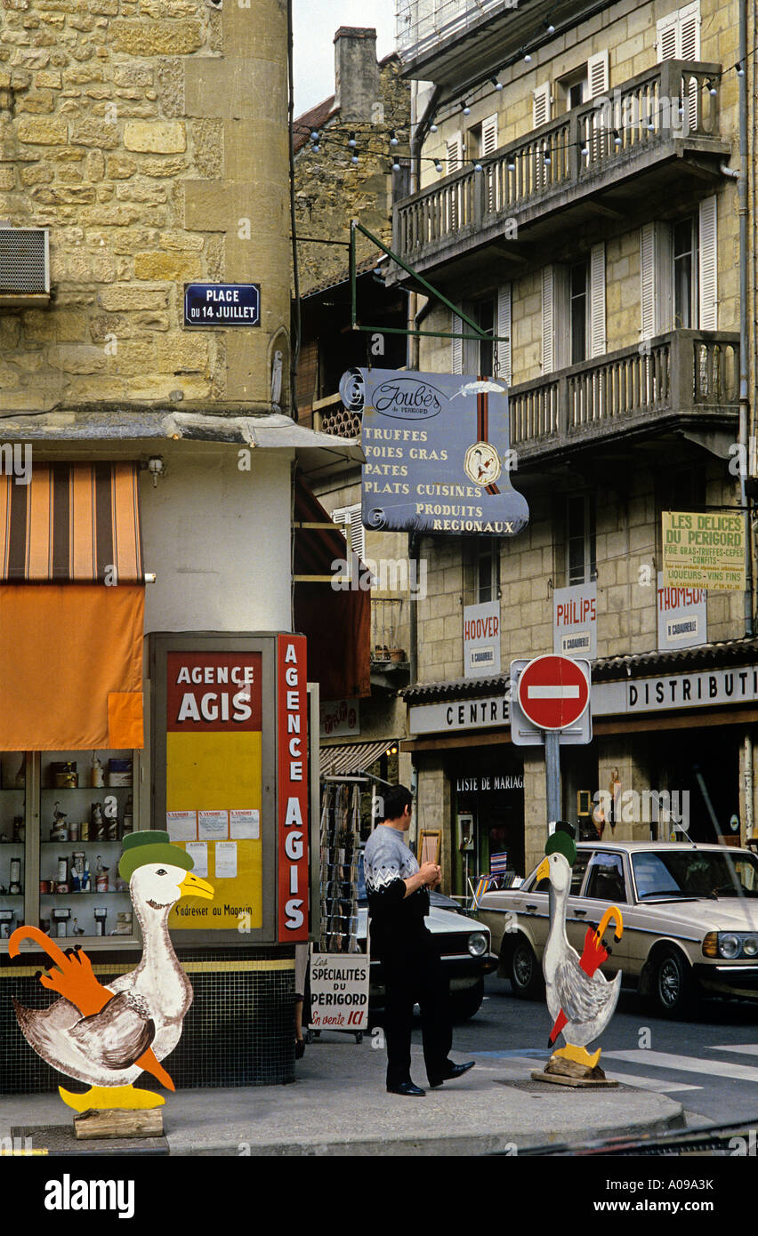 The streets of Sarlat with decorations and signs indication the specialities of The Dordogne such as Foies Gras and Truffles - Stock Image