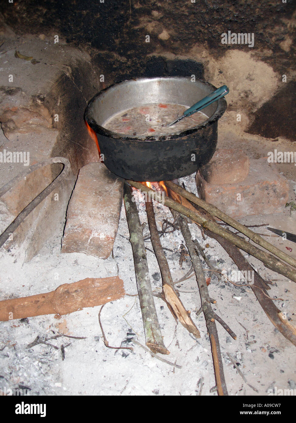 Boiling a broth on firewood - Stock Image