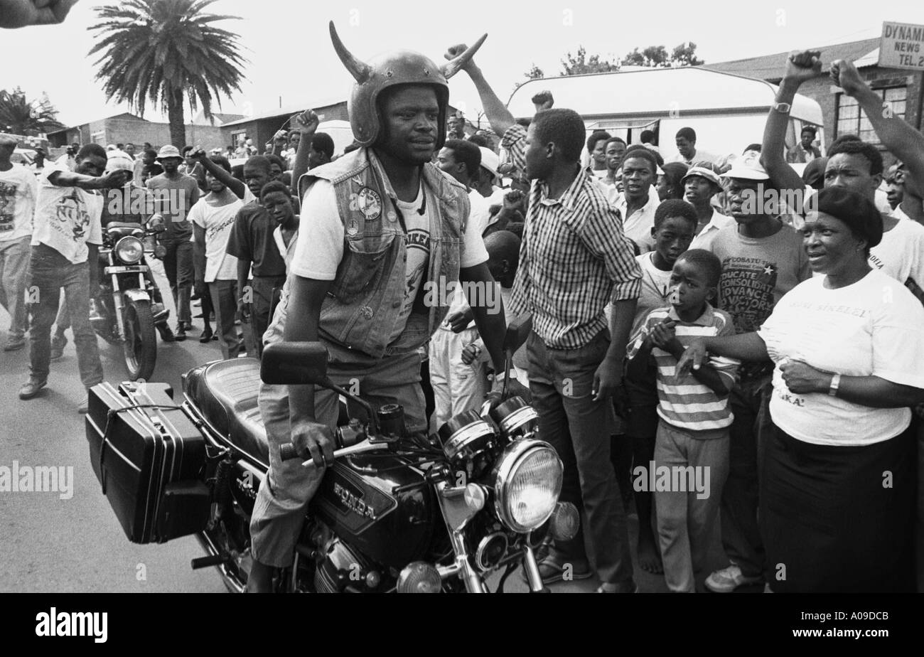South Africa. Soweto. Crowds celebrating Nelson Mandela's release from prison and awaiting his return outside his home. Man on motor cycle. - Stock Image