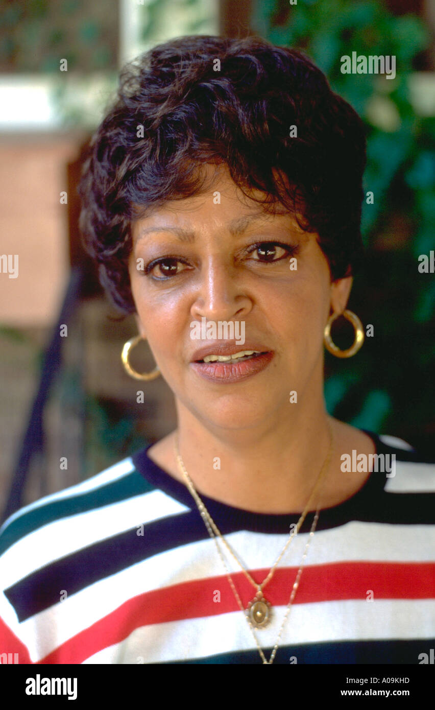 mature black african american woman age 60 looking concerned and