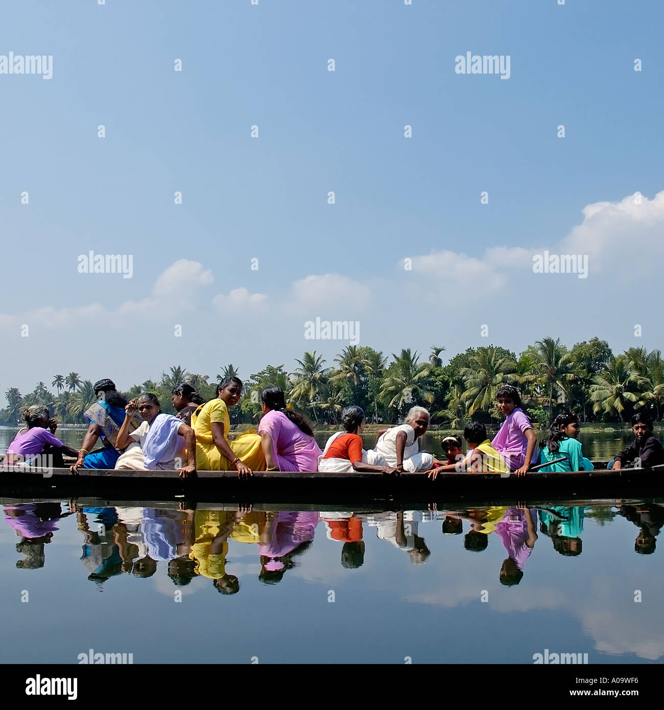 Women and children in a taxi canoe on the backwaters of kerala South India Stock Photo