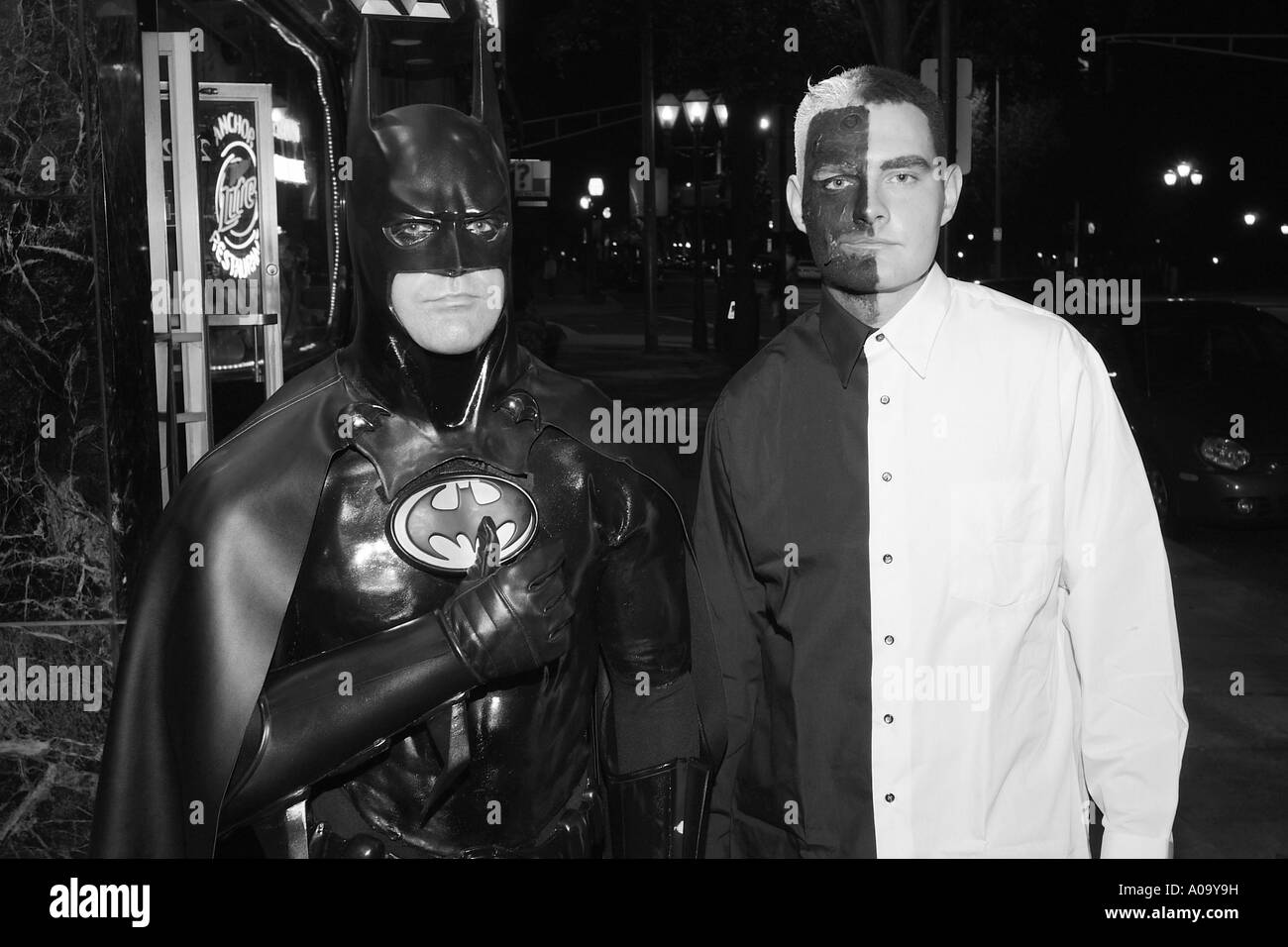 Adults dressed in costume for Halloween black and white documentary style street photography - Stock Image & Batman Costume Black and White Stock Photos u0026 Images - Alamy