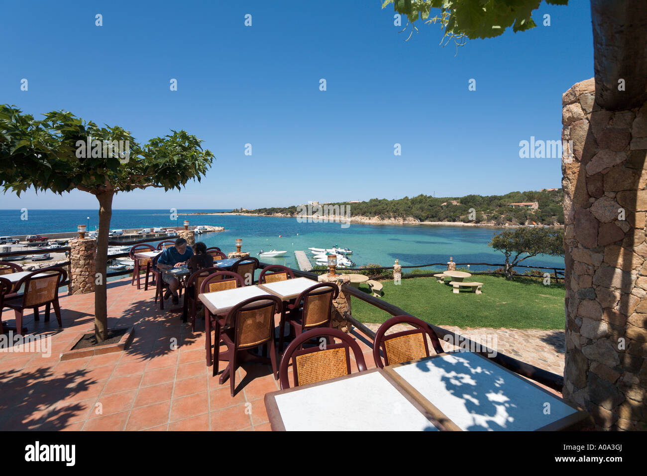 Terrace of a seafront restaurant in the resort centre, Tizzano, near Sartene, Corsica, France Stock Photo