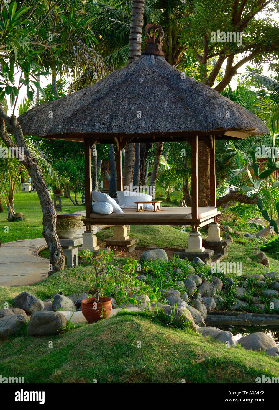 Bali holiday resort - thatched native day bed by the beach, eastern ...