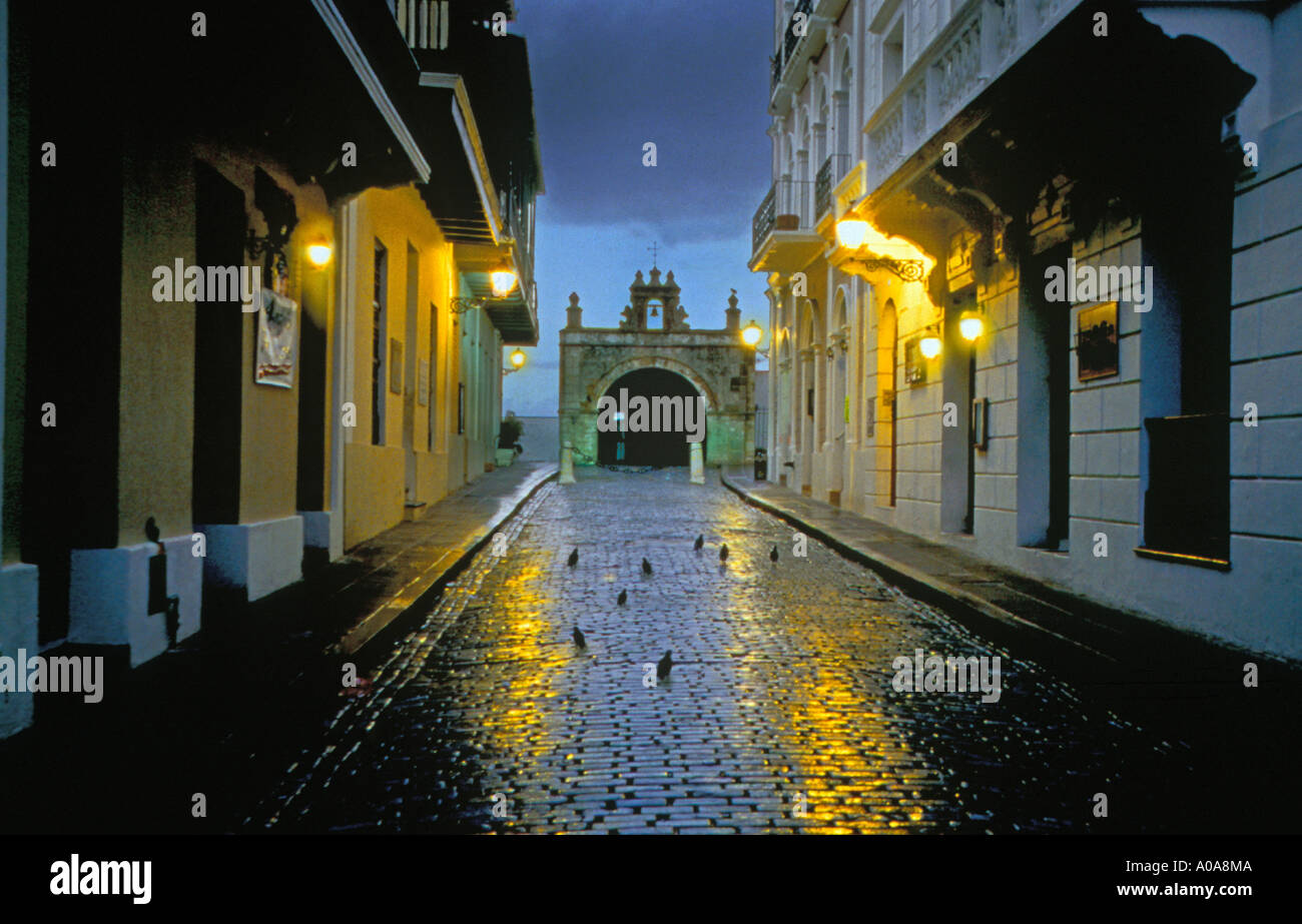 USA CARIBBEAN PUERTO RICO OLD SAN JUAN Sreet light reflecting on rain covered brick streets Historic Cristo Chapel in background - Stock Image