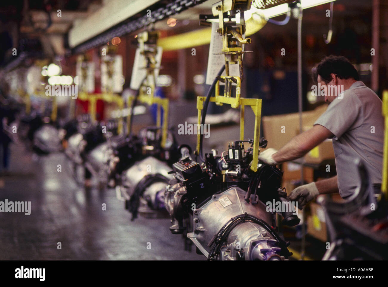 Workers assemble engines at General Motors plant in Baltimore Maryland Stock Photo