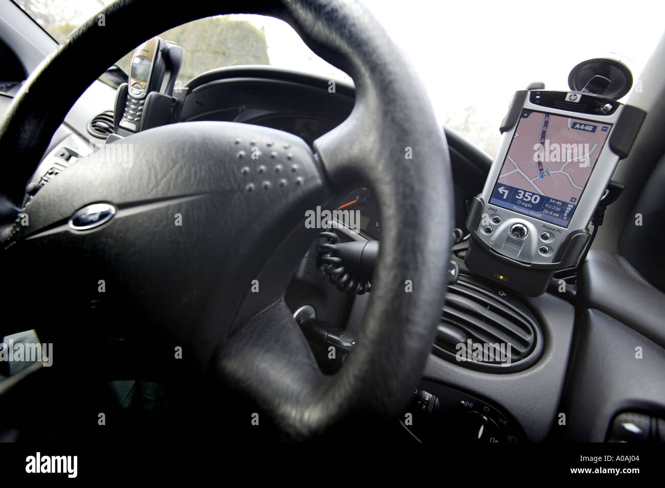 A Pocket PC GPS system mounted in a car - Stock Image