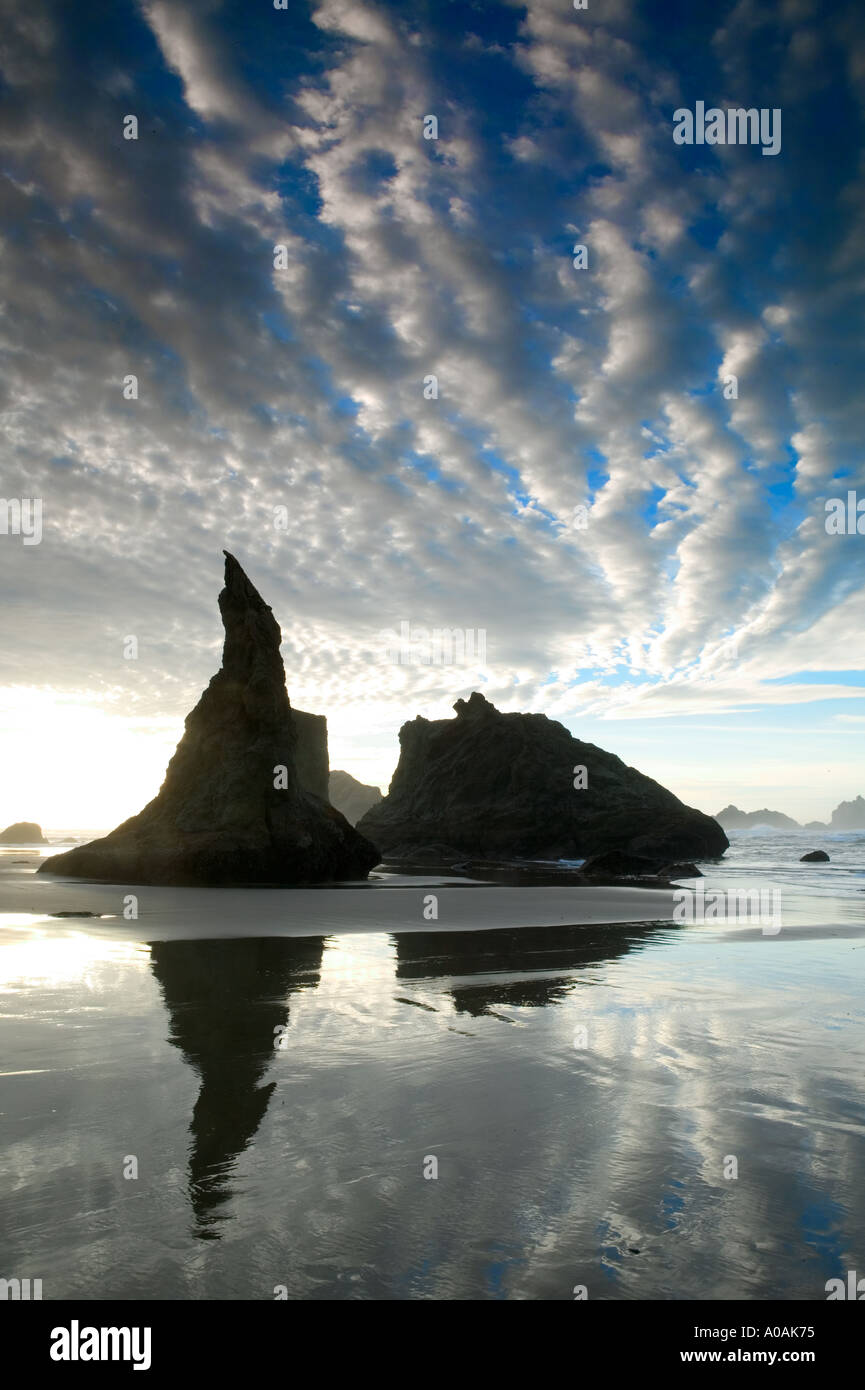 Reflection at low tide with storm clouds Bandon Oregon - Stock Image