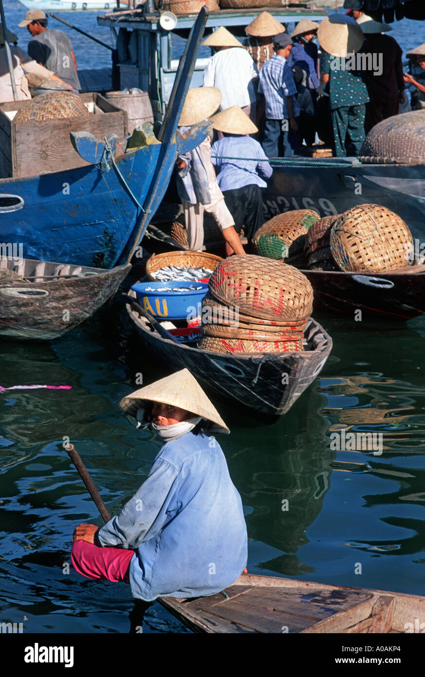 Vietnamese women offering a boat to shore water taxi service plying for business on the Thu Bon river at Hoi An Vietnam - Stock Image