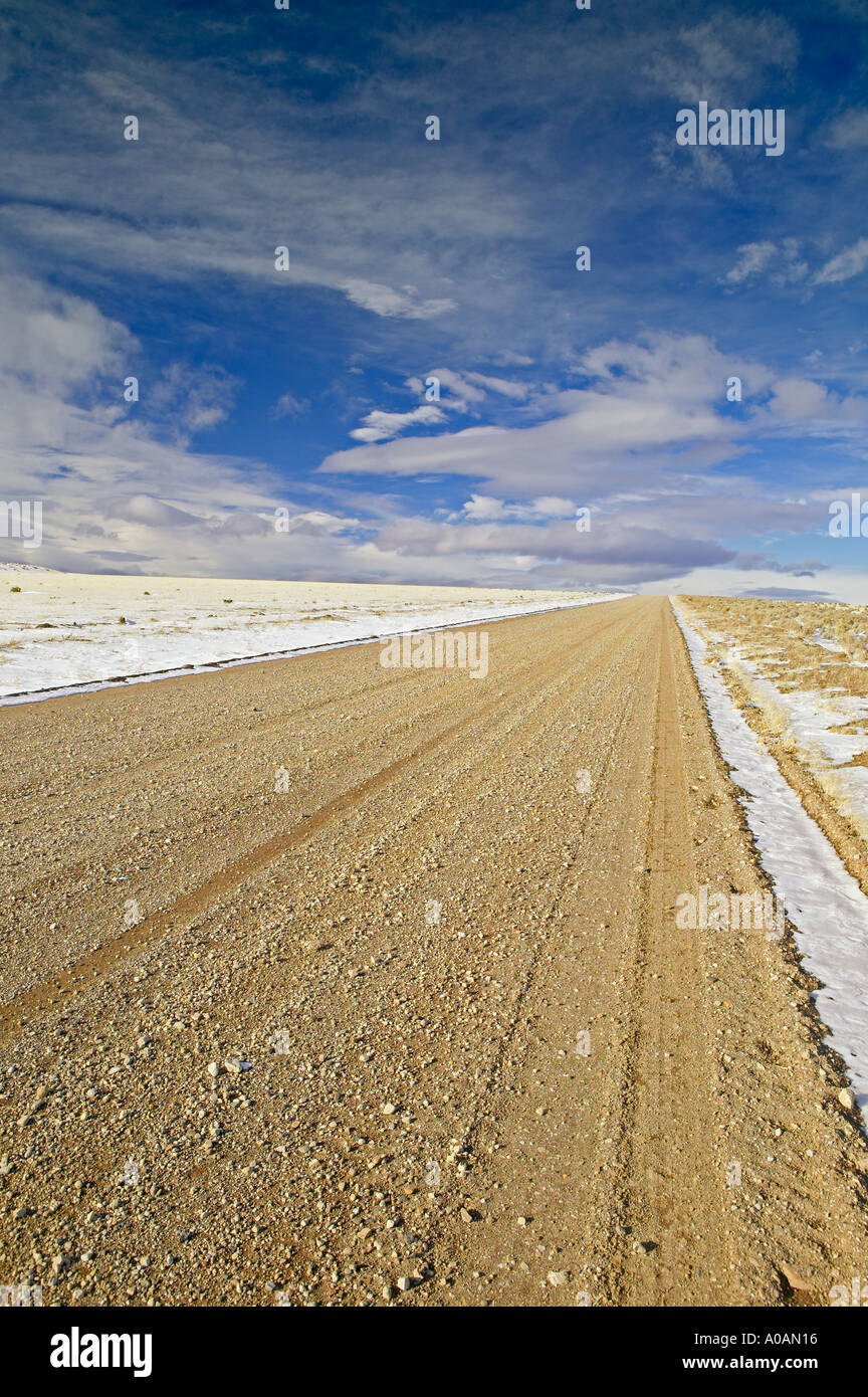 Dirt road with snow near Warner Valley Oregon - Stock Image