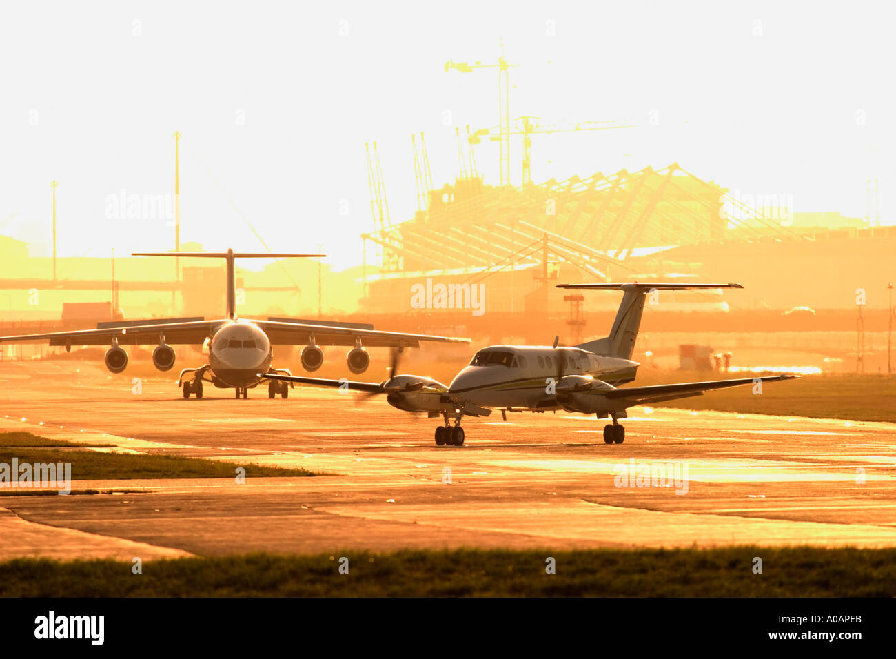 Two airplanes on runway in queue for departure - Stock Image