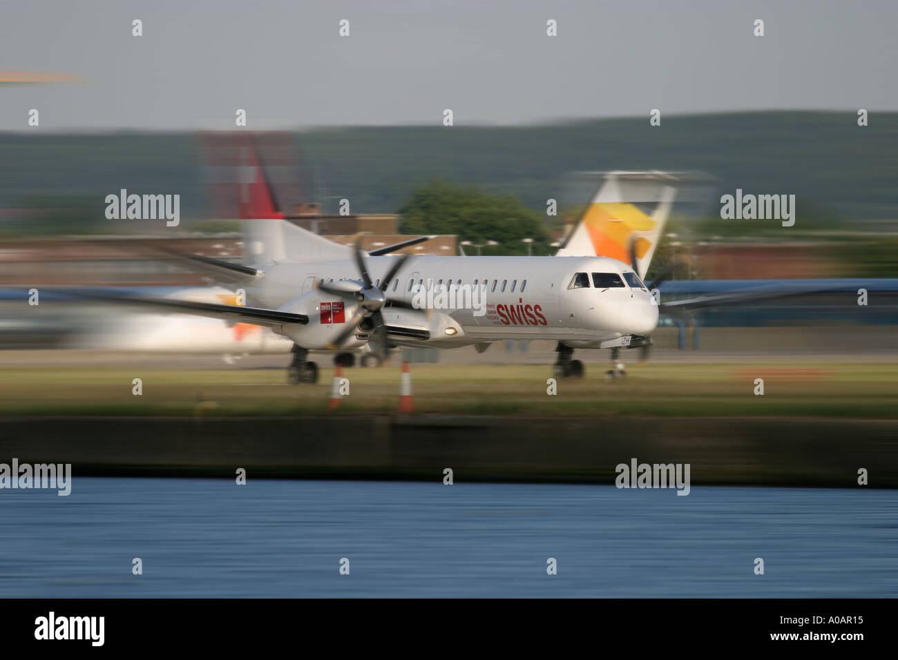 Swiss International Air Lines Saab 2000 HB IZH London City Airport UK - Stock Image