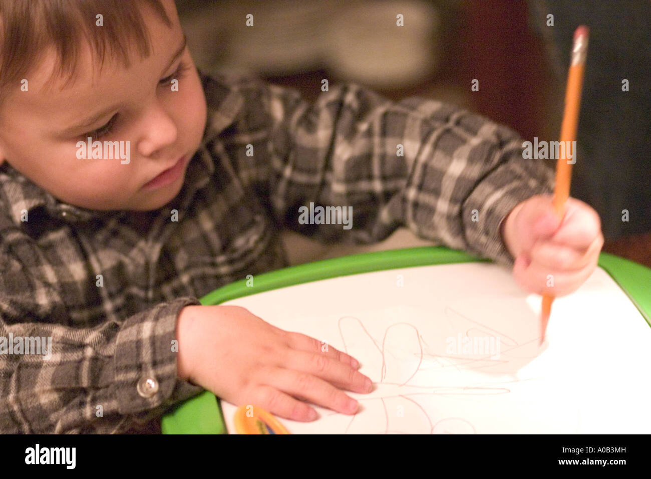 Boy age 2 drawing with Crayola Trace-N-Draw Projector. Plymouth Minnesota MN USA - Stock Image