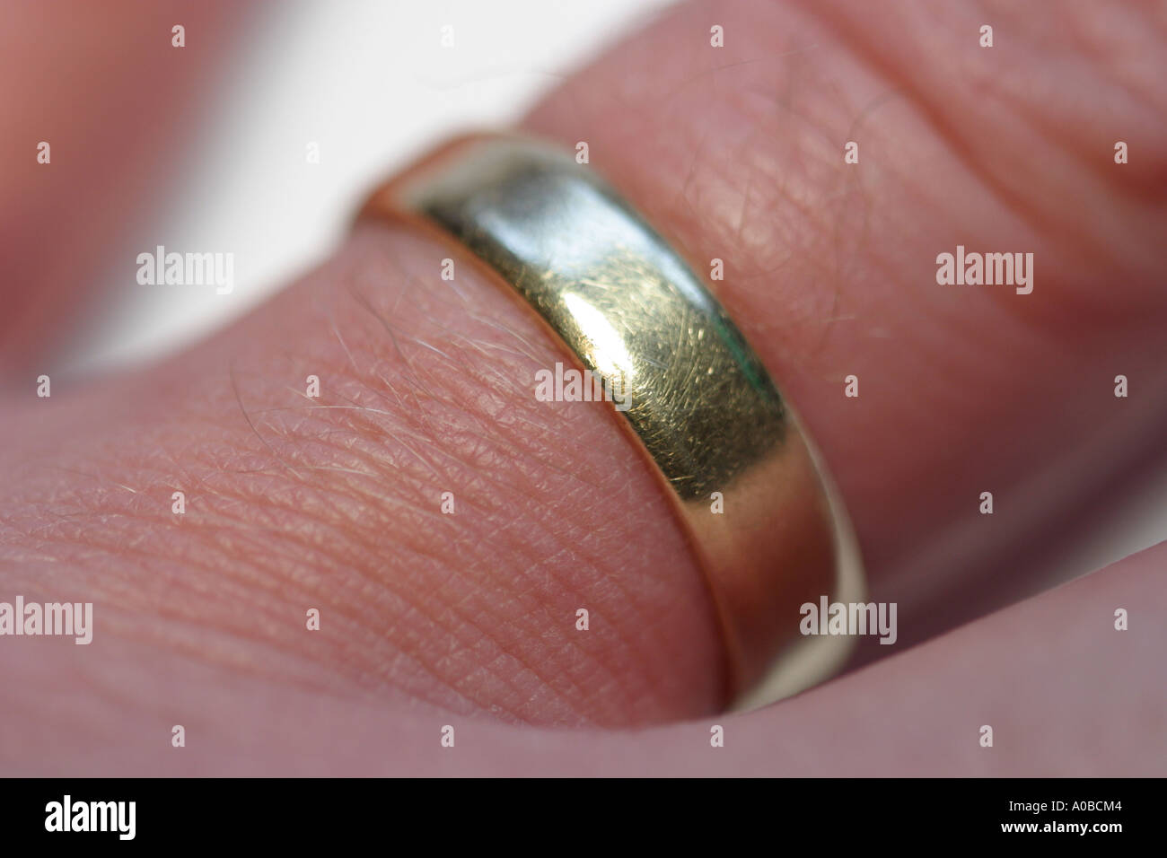 Wedding ring on a mans hand - Stock Image