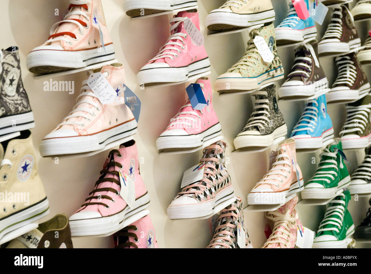 Rows of Converse All Star shoes in shop England UK - Stock Image