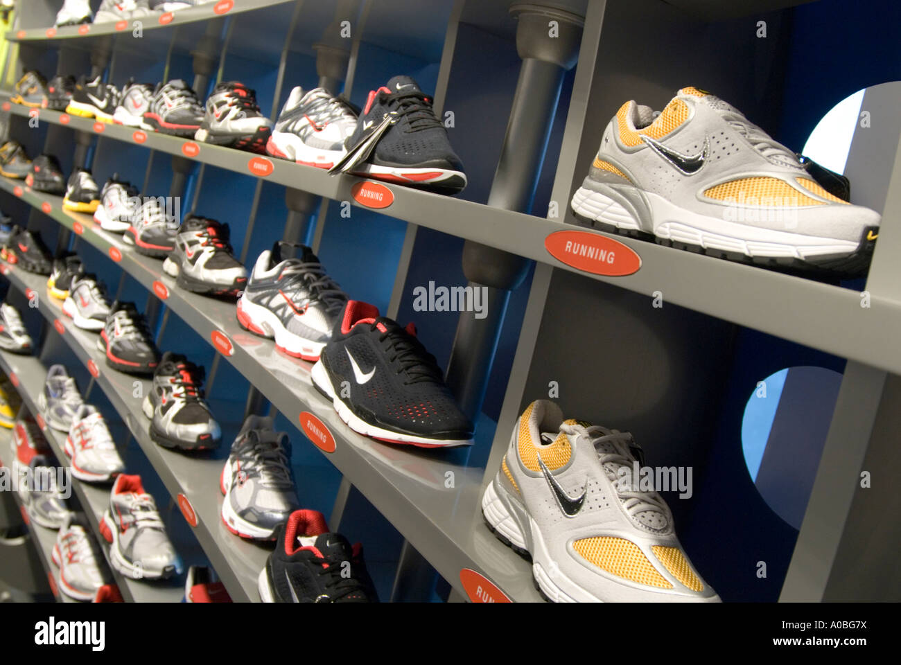Arturo Beca Forma del barco  Rows of Nike trainers in Niketown London England UK Stock Photo - Alamy