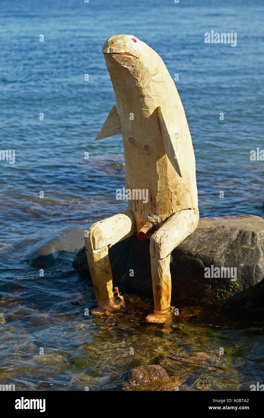 Funny Wooden Sculpture Beside The Little Mermaid Statue Copenhagen