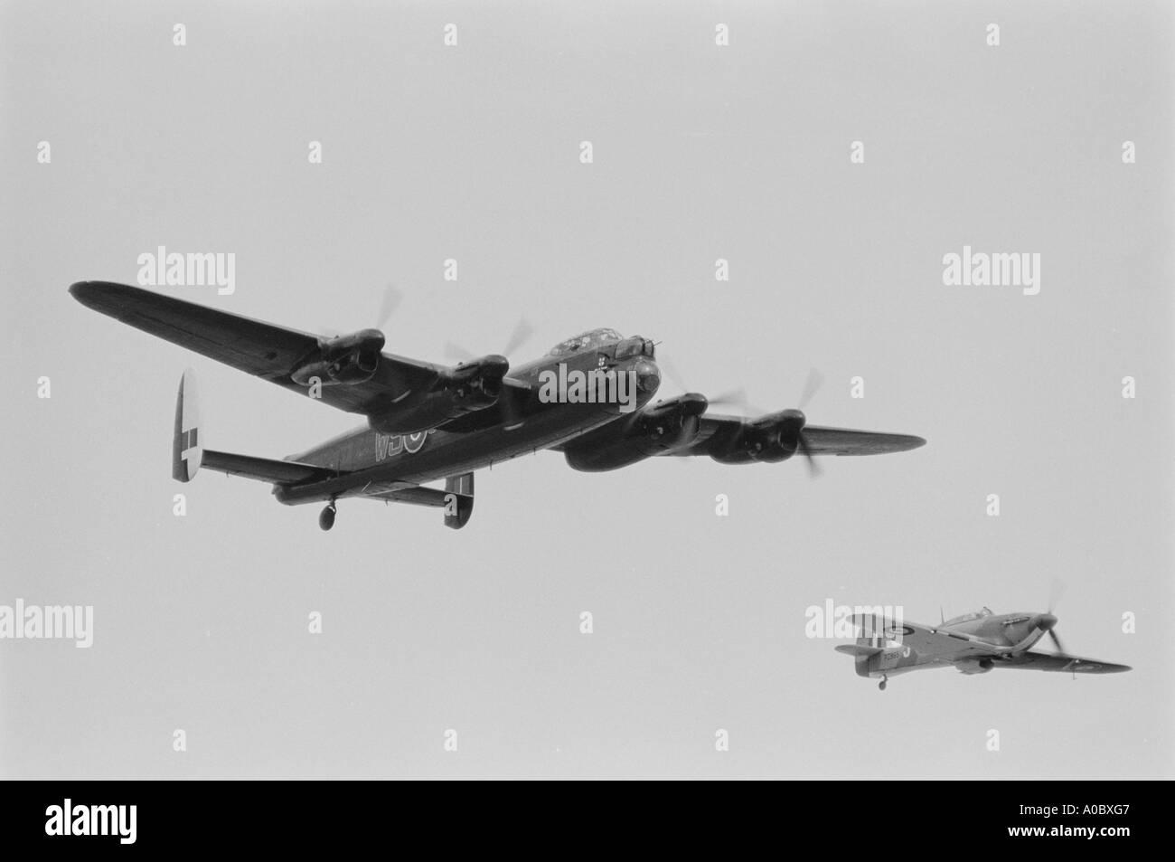 Lancaster bomber and Hurricane fighter escort from the battle of britain memorial flight - Stock Image