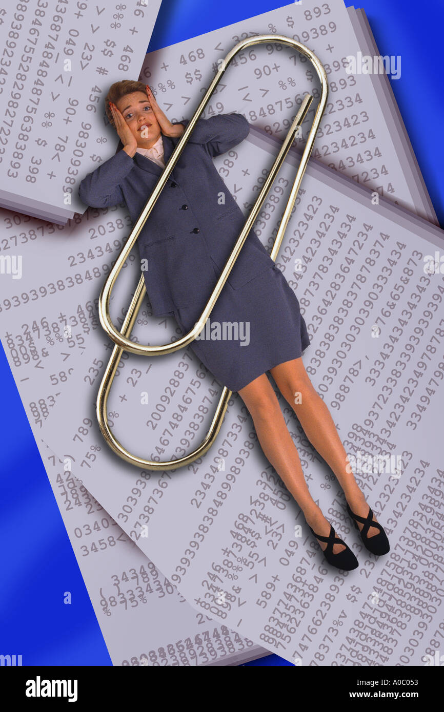 Business woman trapped in paper clip Stock Photo