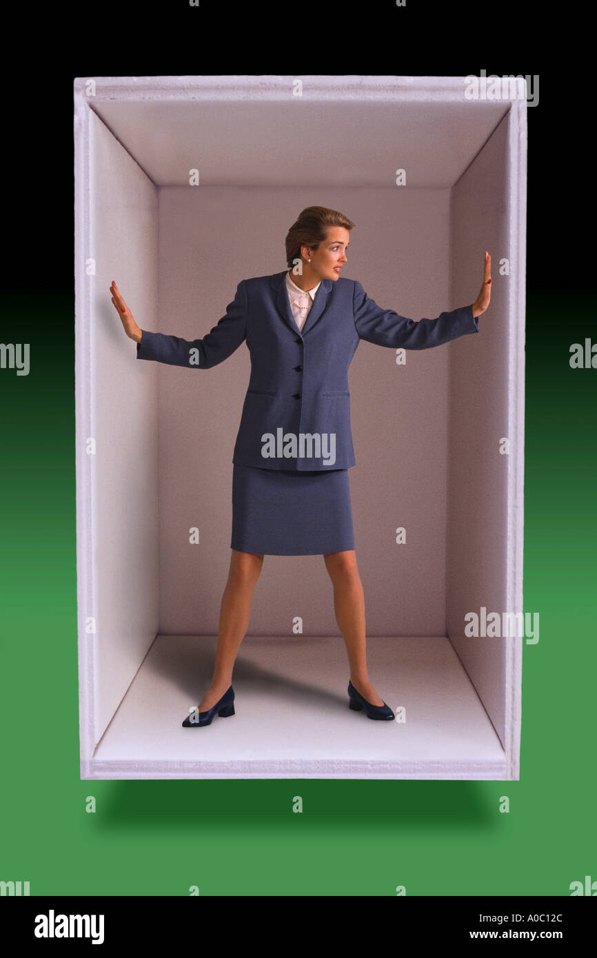 Businesswoman trapped in box Stock Photo
