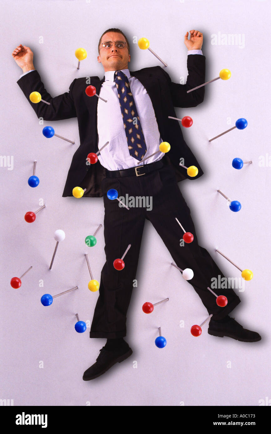 Businessman push pinned to wall - Stock Image