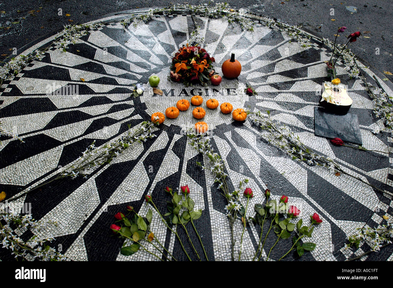The Imagine mosaic in Strawberry Fields memorializing John Lennon in Central Park in the autumn - Stock Image