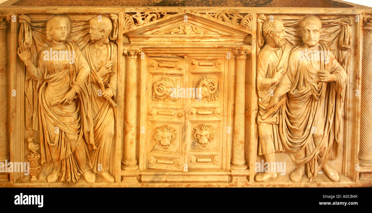 Roman sarcophogus 3rd century with carved figures by doorway - Stock Image