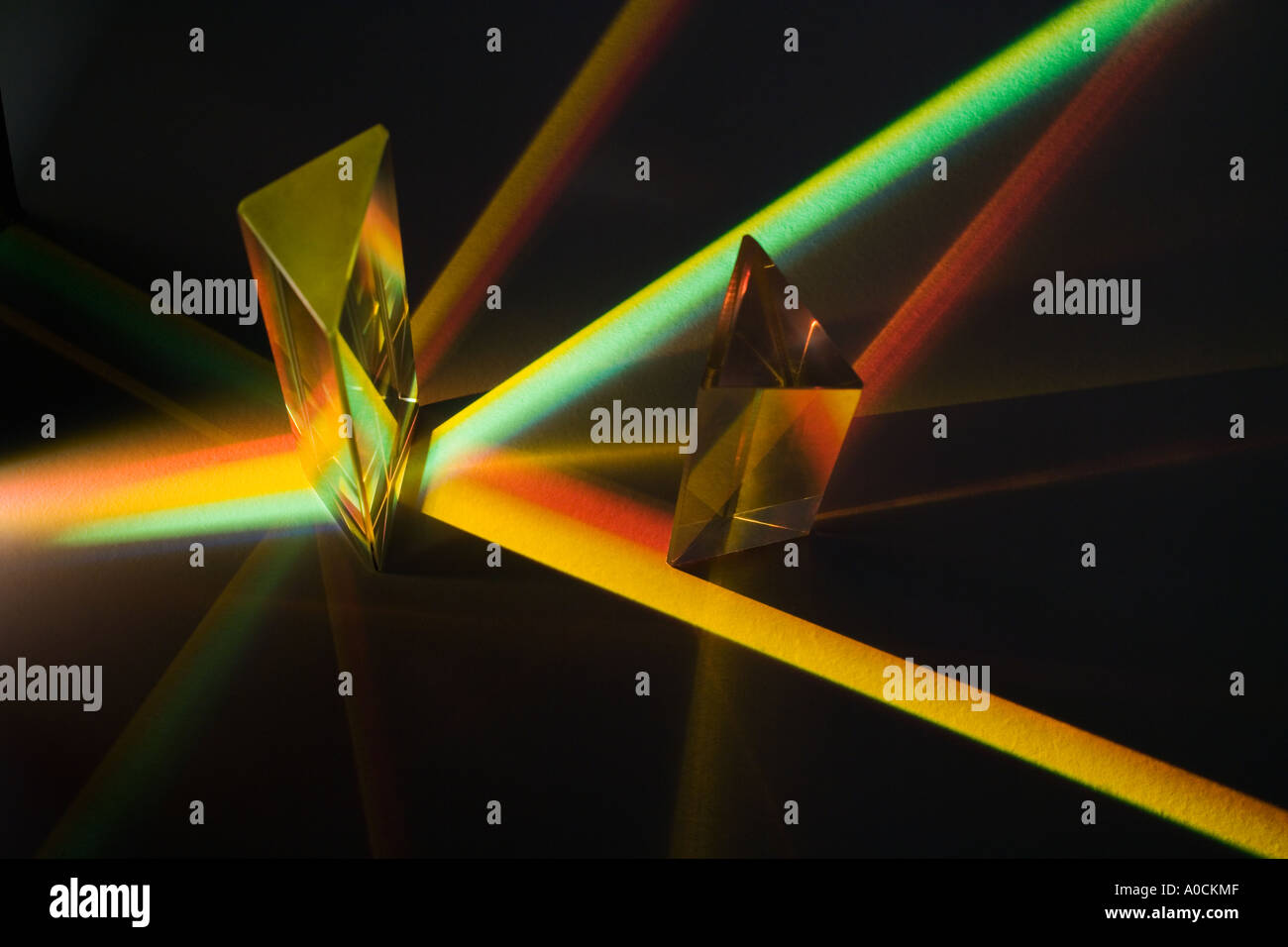 Light passing through two prisms - Stock Image