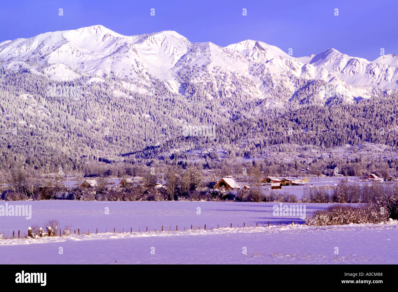 Farmland and Wallowa Mountains Near Halfway Oregon - Stock Image
