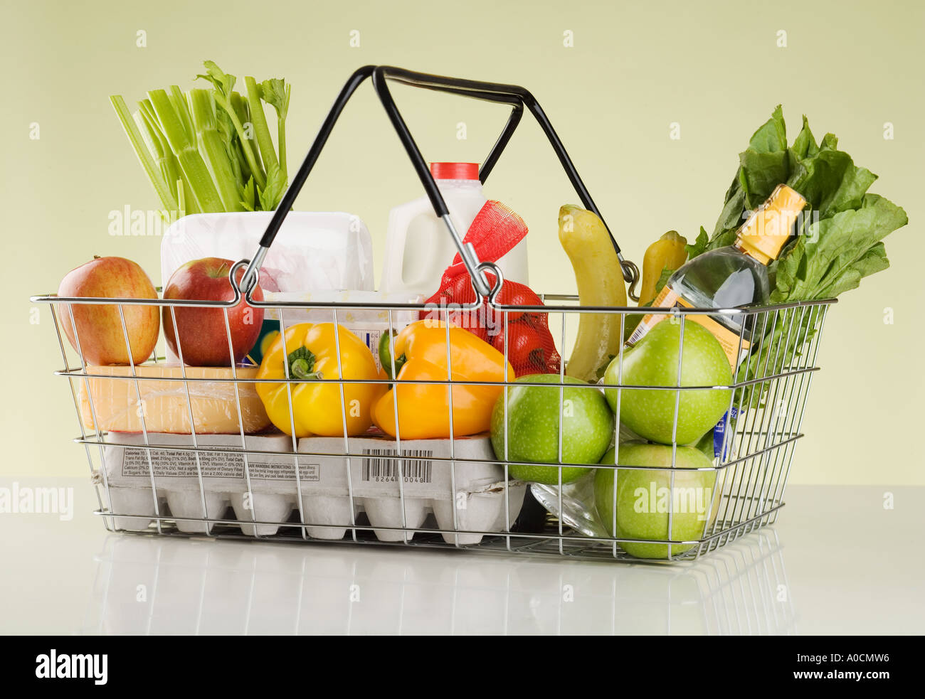 Still life of groceries in basket - Stock Image