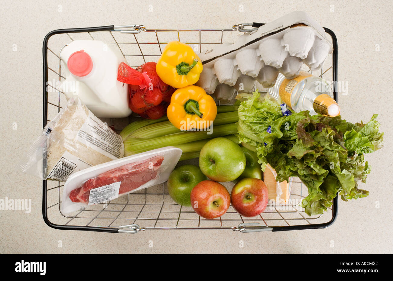 Overhead view of groceries in basket - Stock Image