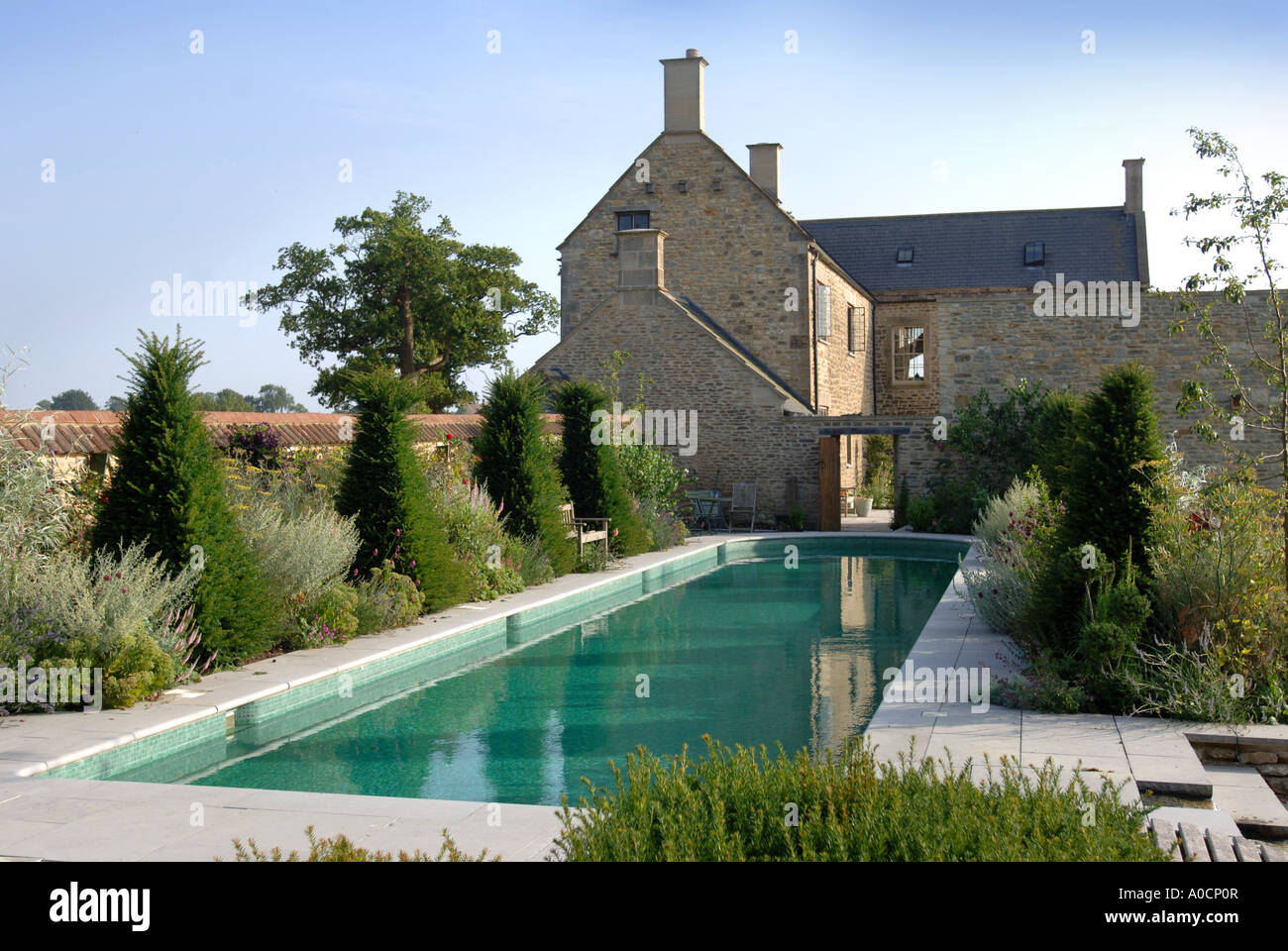 A LUXURY SWIMMING POOL IN THE GARDEN OF LARGE COUNTRY HOUSE WILTSHIRE UK